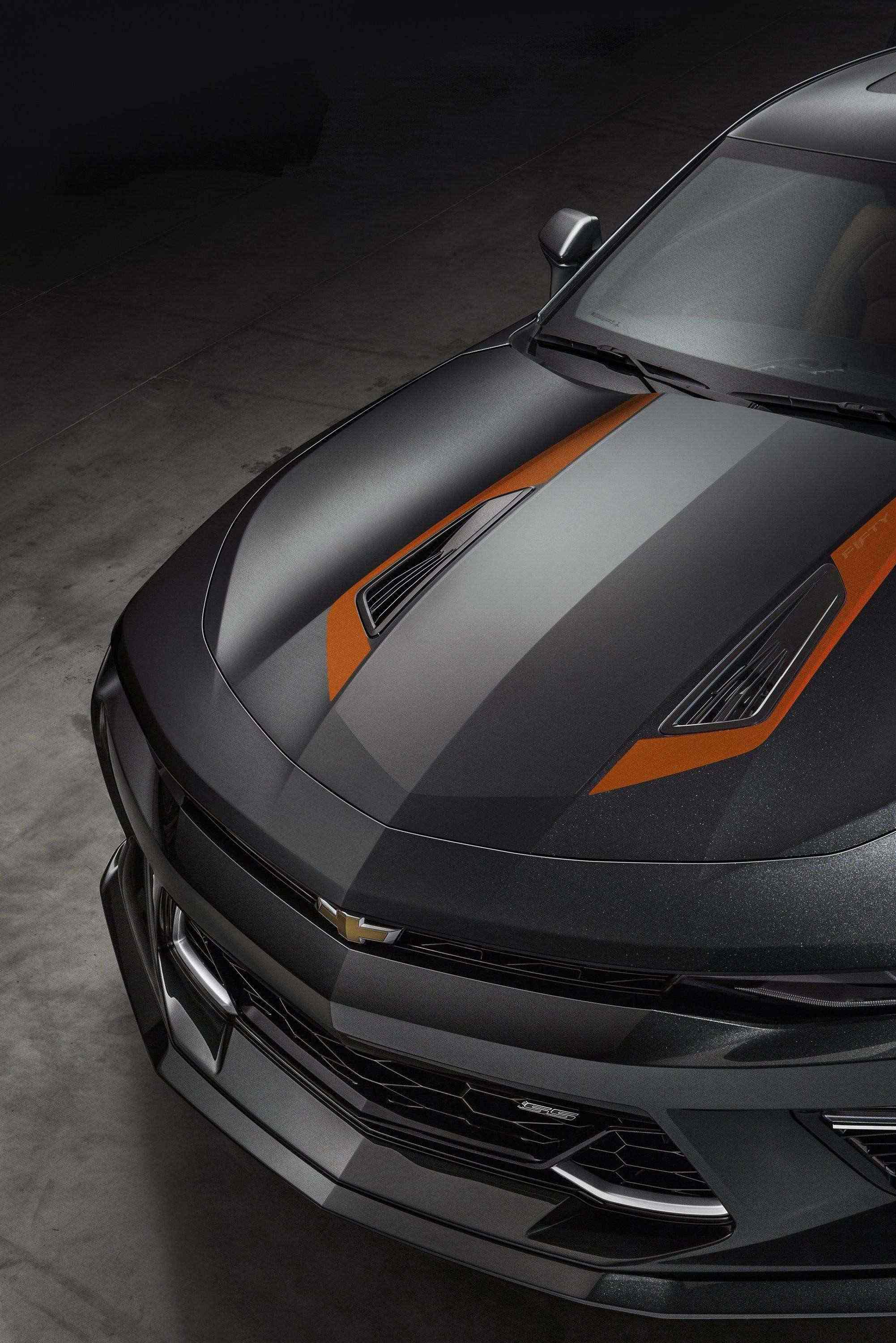 "The 2017 Camaro 50th Anniversary Special Edition is available summer 2016 on 2LT and 2SS coupe or convertible models. The Special Edition features a Nightfall Gray exterior, unique 20"" wheels and center caps, orange stripe package and a black interior with suede accents and orange stitching. Distinct 50th anniversary badging treatment is featured on seatbacks, the steering wheel badge and illuminated sill plates. For the 2017 model year, every Camaro built will feature a special 50th Anniversary badge on the steering wheel."