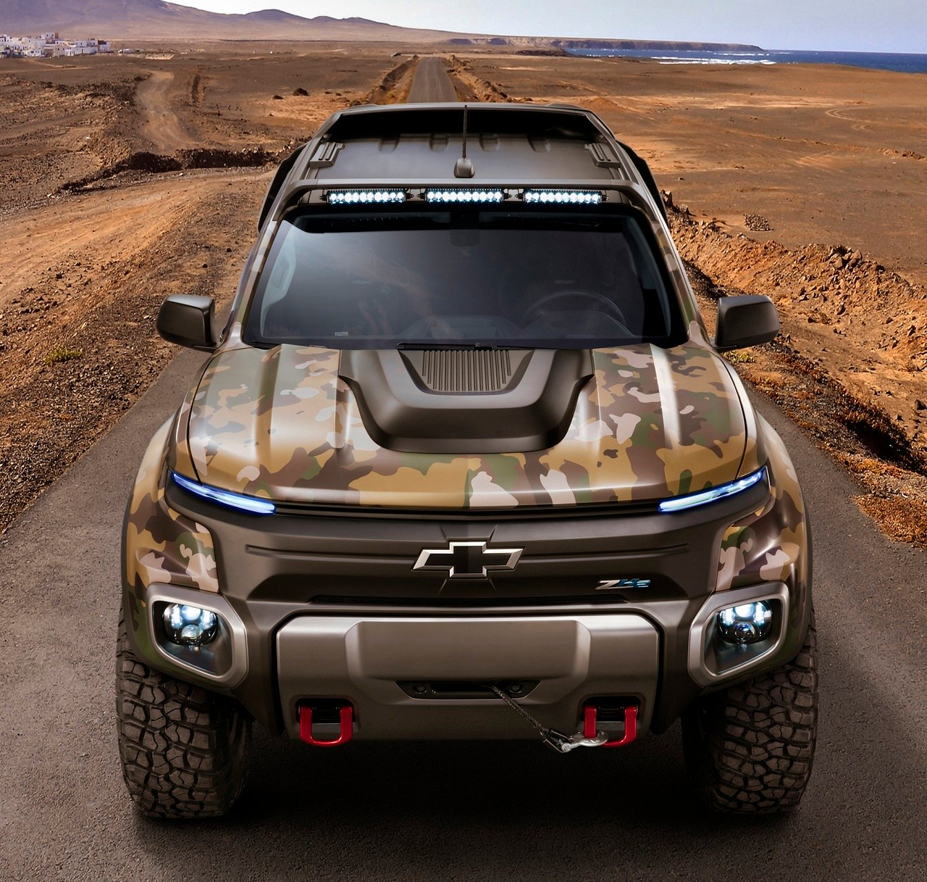 The Chevrolet Colorado ZH2 fuel cell electric vehicle, revealed Monday at the Association of U.S. Army Show in Washington, D.C., strikes an aggressive pose with a power dome on its hood to denote the presence of the hydrogen-powered fuel cell system underneath. General Motors and the U.S. Army Tank Automotive Research, Development and Engineering Center (TARDEC) collaborated on the vehicle, which went from contract to completion in a year.